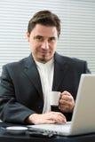 Businessman drinking coffee Royalty Free Stock Image