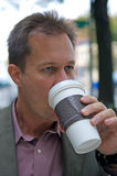 Businessman drinking coffee Royalty Free Stock Photography