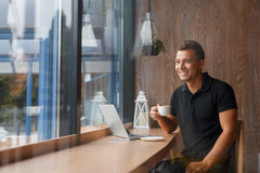 Businessman drinking coffee in the city cafe during lunch time Stock Image