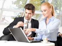 Businessman drinking coffee with his colleague Stock Image