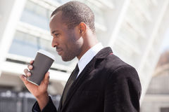 Businessman drinking coffee during a lunch Royalty Free Stock Photos