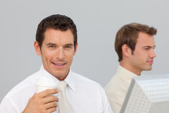 Businessman drinking coffee in the office Royalty Free Stock Images