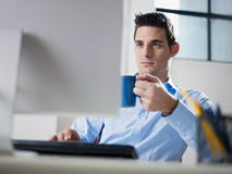 Businessman drinking coffee in office Royalty Free Stock Photo