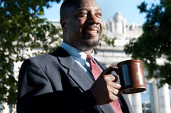 Businessman Drinking Coffee Outdoors Royalty Free Stock Photos