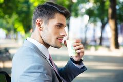 Businessman drinking coffee outdoors Stock Photography