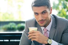 Businessman drinking coffee outdoors Stock Photos