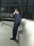 Businessman Drinking Coffee Outdoors Stock Images