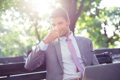 Businessman drinking coffee outdoors Royalty Free Stock Photo