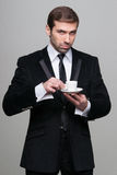Businessman drinking coffee Stock Images