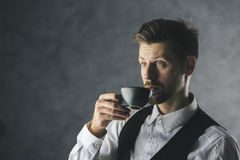 Businessman drinking coffee Stock Photos