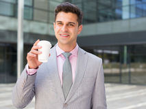Businessman drinking coffee stock photography