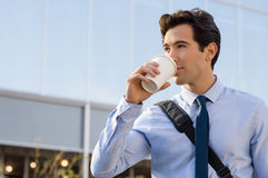 Businessman drinking coffee Stock Photos