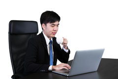 Businessman drinking coffee / tea and using computer Royalty Free Stock Photography