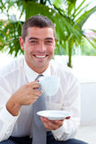 Businessman drinking a cup of coffee Stock Images