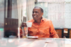 Businessman drinking espresso coffee in a cafe Royalty Free Stock Photo