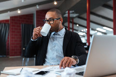 Businessman drinking and listening to music Stock Photo