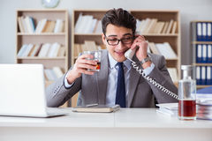 The businessman drinking in the office Royalty Free Stock Photo