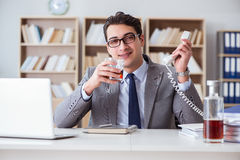 The businessman drinking in the office Royalty Free Stock Photography