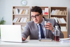 The businessman drinking in the office Royalty Free Stock Image