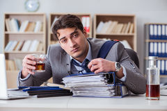 The businessman drinking in the office Stock Photography