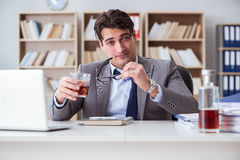 The businessman drinking in the office Royalty Free Stock Images