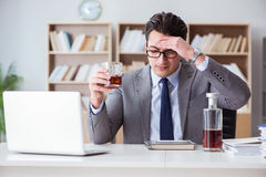 The businessman drinking in the office Royalty Free Stock Photos