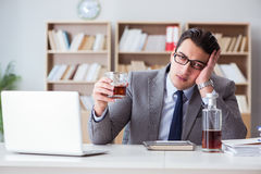 The businessman drinking in the office Stock Photos