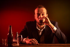 Businessman Drinking a Shot Royalty Free Stock Photo