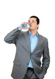 Businessman drinking water Stock Images