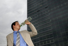 Businessman drinking water