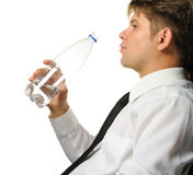 The businessman drinking water from a bottle Stock Image