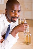 Businessman drinking wine Stock Photos