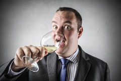Businessman drinking wine Stock Photo