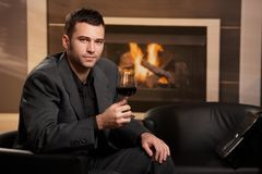 Businessman drinking wine at home Stock Photos