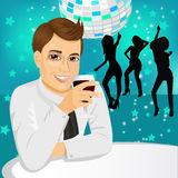 Businessman drinking wine at the party Royalty Free Stock Photography
