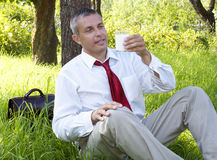 Businessman drinks fresh milk Royalty Free Stock Images