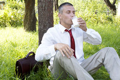 Businessman drinks fresh milk Royalty Free Stock Photography