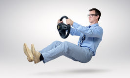 Businessman driver in glasses and tie with a wheel royalty free stock photo