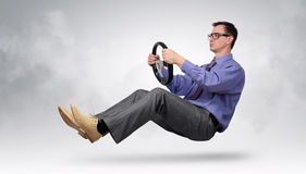 Businessman driver in glasses and tie with a wheel Stock Photography