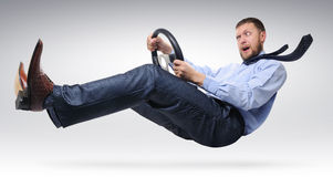 Businessman driver with  a wheel. Businessman driver with open mouth in a tie with a wheel concept Royalty Free Stock Image