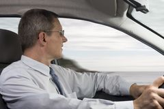 Businessman driving a car Royalty Free Stock Photos