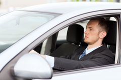 Businessman driving a car Royalty Free Stock Photos