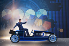 The businessman driving car in financial concept. Businessman driving car in financial concept Stock Photo