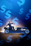 The businessman driving car in money concept Stock Photos