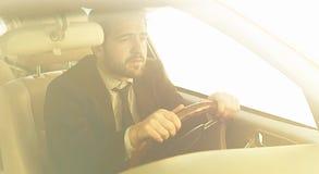 Businessman driving car Stock Image