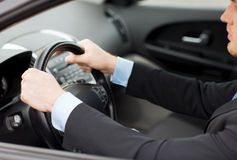 Businessman driving a car Royalty Free Stock Image