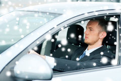 Businessman driving a car Stock Photos