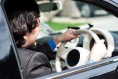Businessman driving his luxury dream car Stock Photo