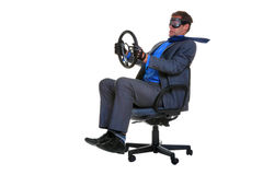Businessman driving an office chair Stock Photography