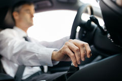 Businessman driving to work Stock Photography